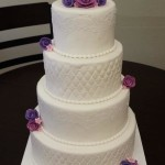 White Wedding Cake with Purple Roses